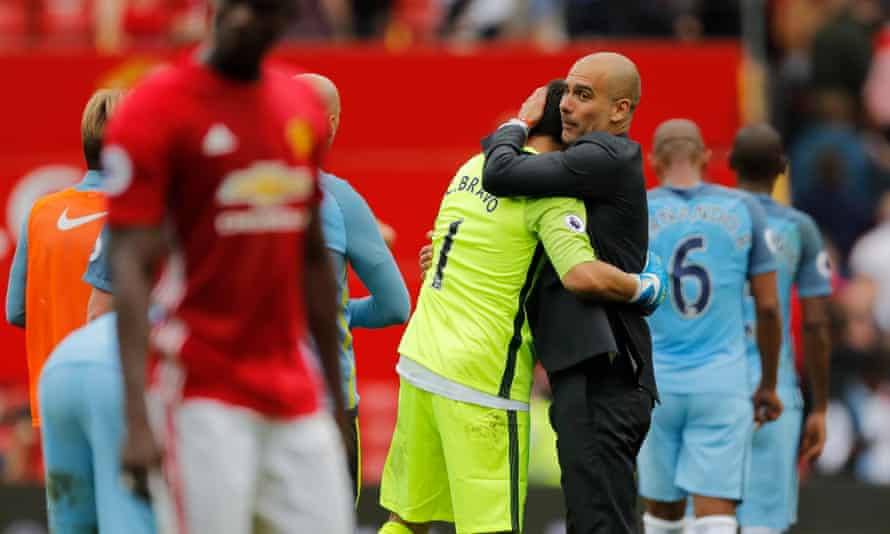 Pep Guardiola hugs his keeper Claudio Bravo after the final whistle.