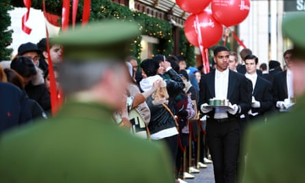 Butlers serve shoppers queuing at the Harrods winter sale on Boxing Day.