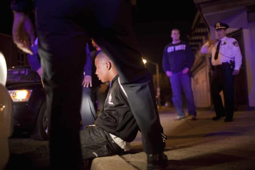 Police officers arrest a suspected drug dealer in Baltimore, Maryland.