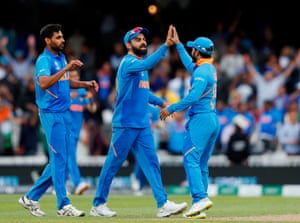 Kohli celebrates with his players after victory.