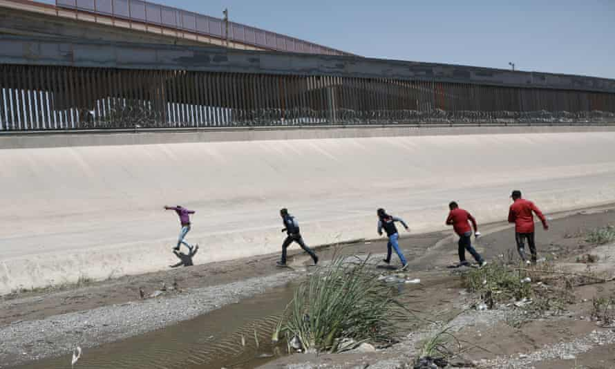 Migrants cross at the US-Mexico border between Ciudad Juarez and El Paso on 15 June 2019.