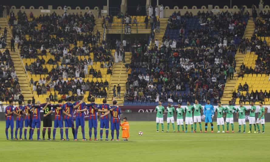 Teams observe one minute of silence during the Qatar Airways Cup match in Doha between Barcelona and Al-Ahli Saudi FC on 13 December 2016