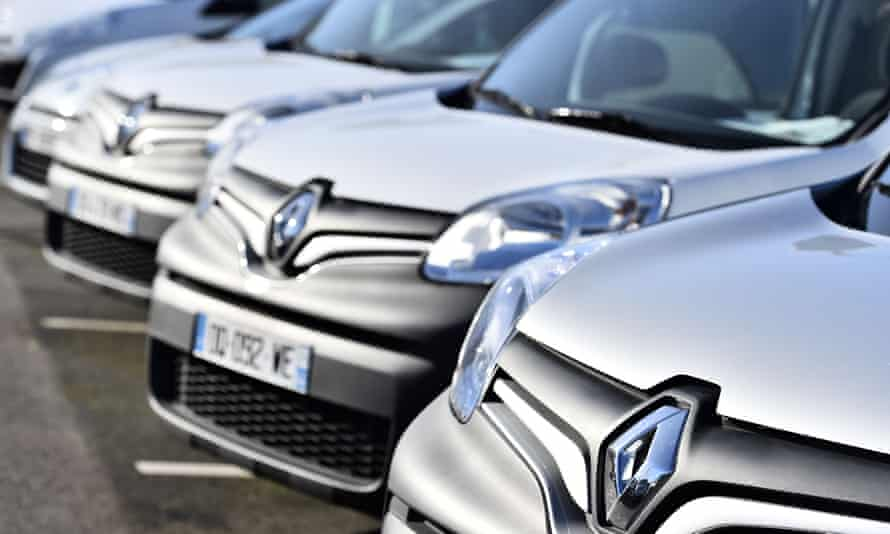 Light grey Renault cars parked outside the factory forecourt