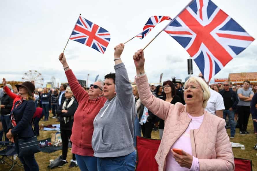 People wave union flags on Southsea Common in Portsmouth