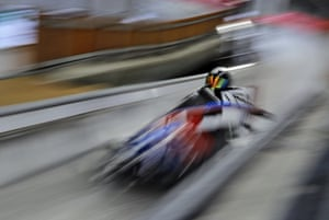 Driver Codie Bascue and Samuel McGuffie of the US take a practice run in the two-man bobsleigh.