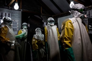 Health workers wear personal protective equipment at an Ebola treatment centre in DRC