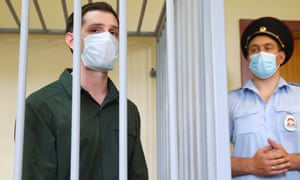 Trevor Reed is watched by security during his sentencing in a Moscow court.