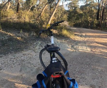 Brigid Delaney riding her electric bike through the countryside