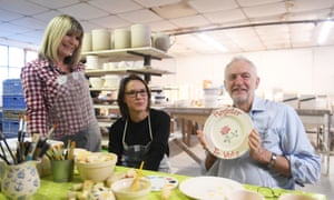Jeremy Corbyn holding a plate with the words 'register to vote' during a visit to a pottery manufacturer in Stoke-on-Trent this morning.