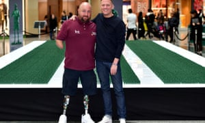 The veteran Dave Watson, left, and the actor Antony Cotton in front of an installation representing each person medically discharged in the past 20 years