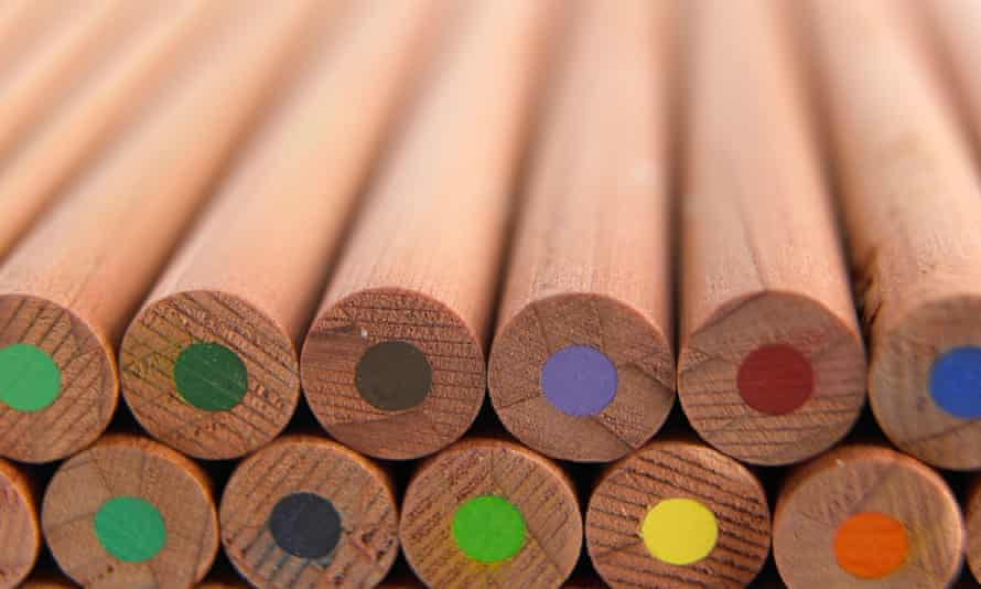 A stack of wooden coloured pencils. with the coloured centres visible at the ends