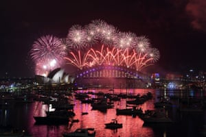 Sydney Opera House and Harbour Bridge turn pink as Australia welcomes in the new year