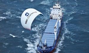 Cargo ship with sail