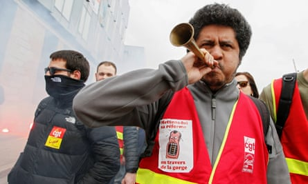 Employees of the French state-owned railway company SNCF attend a demonstration in Lyon as part of a nationwide strike.