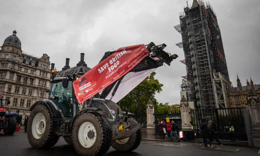 Farmers in tractors take part in a protest over food and farming standards