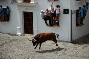 Grazalema, Spain People hold onto windows