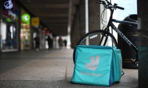 A Deliveroo bag and bike are parked near Victoria Station in central London.