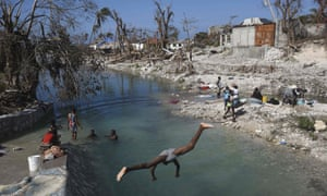 Locals wash clothes in Port Salut south-west of Port-au-Prince on Wednesday.
