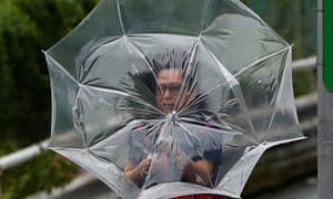 A woman struggles with an umbrella as Typhoon Faxai hit Tokyo on Monday.