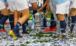 Manchester City players celebrate with the trophy after winning the Women's FA Cup last year.