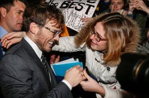 Sam Claflin is given a ring by an Italian fan