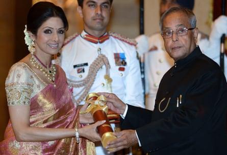 Pranab Mukherjee presents the Padma Shree award to Indian film actress Sridevi in 2013
