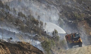 Firefighters work to extinguish a bushfire near Yinnar in Gippsland, Victoria.
