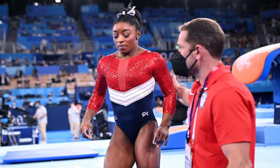 Simone Biles reacts after her opening vault – shortly afterwards she withdrew.