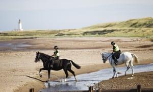 Police patrol the beach near Turnberry