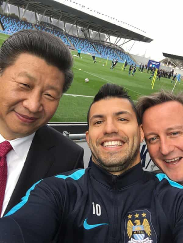 Chinese president Xi Jinping, Man City striker Sergio Aguero and then prime minister David Cameron at MCFC's Etihad stadium in Manchester in 2015.