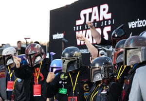 Fans of 'Star Wars: The Last Jedi' watch from their seats on the red carpet during the world premiere at the Shrine Auditorium in Los Angeles, California