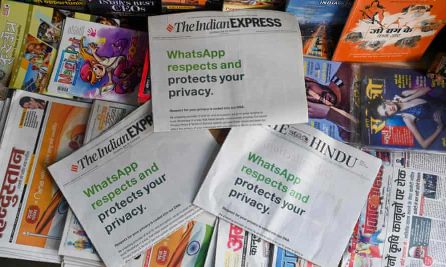 An advertisement from WhatsApp is seen in a newspaper at a stall in New Delhi