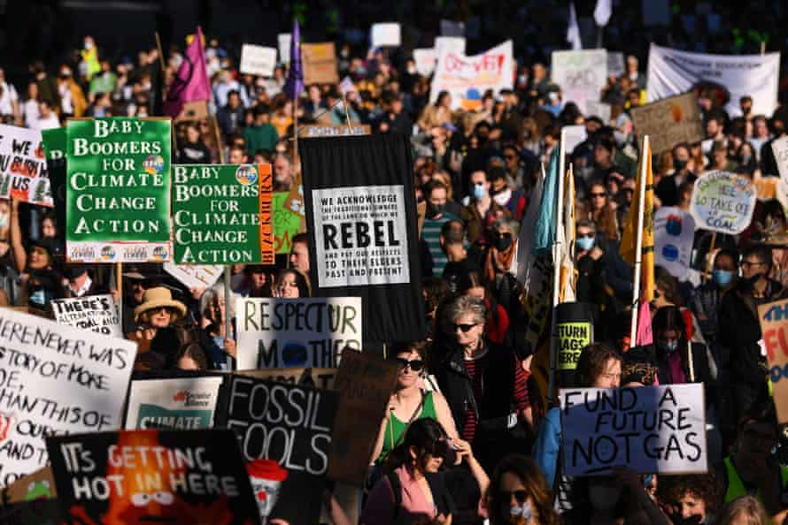 Climate strikers march in Melbourne on Friday.