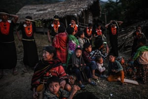 At dawn, the villagers watching continue to watch the ceremony