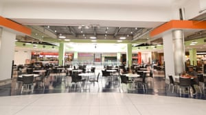 A few solitary diners eat at the food court in Manchester's Arndale Centre