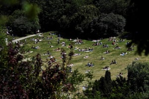 Paris, France: people relax in the Buttes Chaumont park on the first day of its reopening, as France eases lockdown measures taken to curb the spread of coronavirus