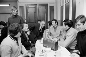 With Liverpool manager Bill Shankly listening to the FA Cup draw over lunch at their ground. They are with Alun Evans, Emlyn Hughes, Ron Yeats and Geoff Strong in 1969.