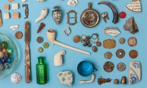 A collection of historical artefacts found on the banks of the river Thames, laid out on a blue background