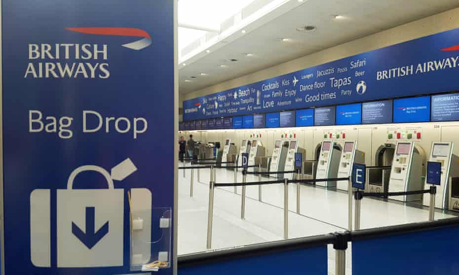 An empty bank of British Airways check-in desks at Gatwick airport