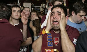 Arsenal fans watch their team lose the 2006 Champions League final to Barcelona at the Gunners pub in Highbury.