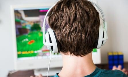 A boy playing Minecraft