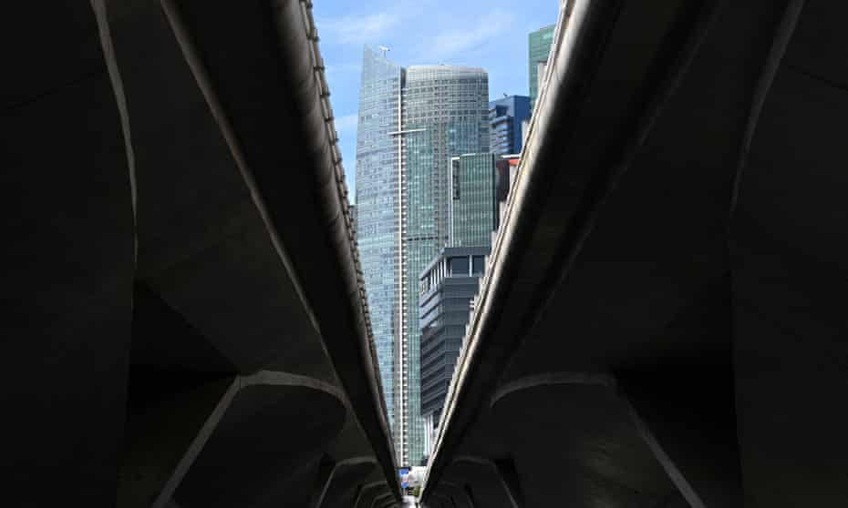 A view of Singapore's financial district between viaducts crossing a river