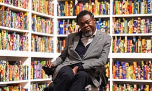 Yinka Shonibare and his work The British Library, at Tate Modern in April.