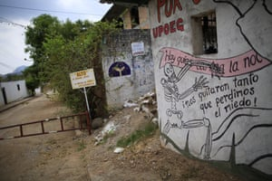 A UPOEG mural at a blocked-off town entrance in Buenavista reads: 'They took so much from us that we lost our fear.'