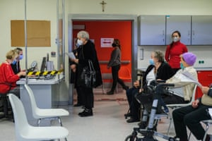Elderly people wear face masks at an observation room after being given a Pfizer/BioNTech Covid-19 jab at the Krakow University hospital on Monday.