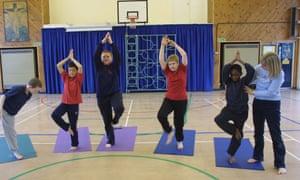 School children in school yoga class