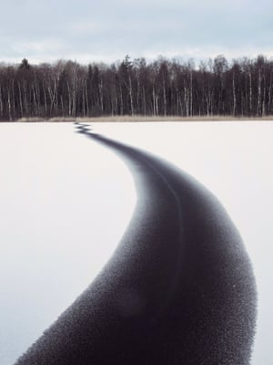 The art of ecology category winner: Jesamine Bartlett. A crack in a Swedish lake stretches the entire width of the lake.