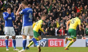 Timm Klose celebrates as Ipswich players react to the Norwich defender's last-gasp equaliser.