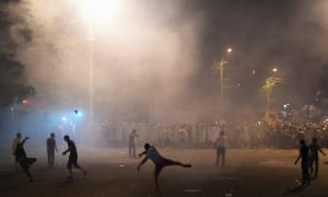 Demonstrators who had gathered in show of support for gunmen holding several hostages in police station, clash with riot police in Yerevan.