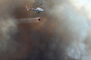 A helicopter fights a forest fire at Alijo, northern Portugal